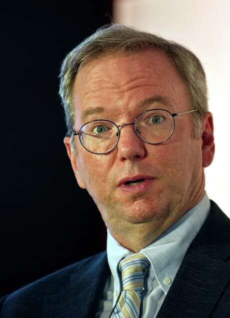 "(FILES) In a file picture taken on March 20, 2013 Google Executive Chairman Eric Schmidt gestures as he addresses a gathering at the National Association of Software and Services Companies (NASSCOM) startup event in New Delhi.  Schmidt is in the Indian capital to take part in the Big Tent Activate summit on March 21. A top Google executive on April 22 insisted that the company's ""key"" role in developing Britain's electronic commerce sector should be taken into account in the row over its controversial tax arrangements. According to figures cited by Conservative MP Charlie Elphicke, Google paid only 3.4 million GBP (5.4 million USD, 4.2 million Euros) in British corporation tax in 2011 on revenues totalling about 2.5 billion GBP, sparking fury in austerity-hit Britain. But Google's executive chairman Eric Schmidt told BBC Radio 4's World at One programme the company had not acted illegally and had contributed significantly to Britain's economic growth. AFP PHOTO/ MANAN VATSYAYANAMANAN VATSYAYANA/AFP/Getty Images Photo: MANAN VATSYAYANA, Stringer / AFP"