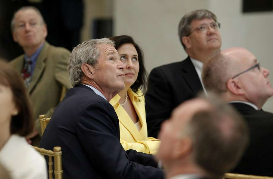 Former President George W. Bush and his guests watch a 360-degree video projected on the rotunda of Freedom Hall at the new George W. Bush Presidential Center in Dallas, Texas, Wednesday, April 24, 2013. Photo: Paul Moseley, McClatchy-Tribune News Service