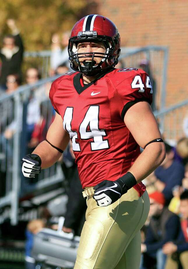 FILE - In this Nov. 17, 2012 file photo, Harvard tight end Kyle Juszczyk (44) reacts after a play during an NCAA college football game against Yale in Cambridge, Mass. The Ivy League is a rich breeding ground for doctors, lawyers and economists. But it doesn't produce very many players drafted by the NFL. This year it's different. Three Ivy Leaguers have a good chance of being taken during the three-day draft that starts Thursday night, April 25, 2013.  (AP Photo/Mary Schwalm, FIle) Photo: Mary Schwalm