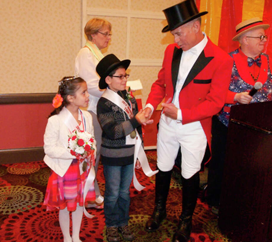 The Barnum Festival winners of the Tom Thumb & Lavinia Warren Contest, Nektaria Karagiannis, age 8, of Jane Ryan School of Trumbull  and Sebastian Machado, age 9, representing Our Lady of Assumption School of Fairfield talk with Ringmaster John F. Stafstrom, Jr. The students will join the 2013 RingmasterâÄôs Royal Family and preside over all Festival events. Photo: Contributed Photo / Connecticut Post Contributed