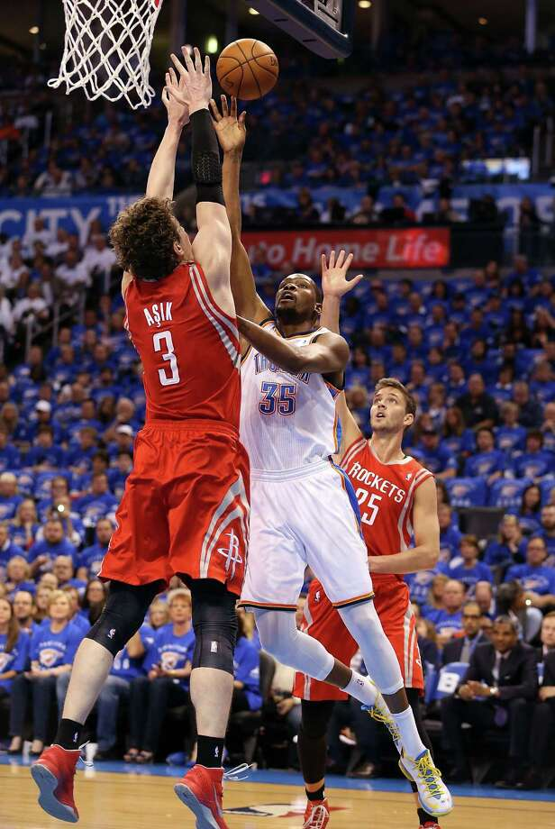 OKLAHOMA CITY, OK - APRIL 24:  Kevin Durant #35 of the Oklahoma City Thunder puts up a shot against Omer Asik #3 and Chandler Parsons #25 of the Houston Rockets during the first quarter of Game Two of the Western Conference Quarterfinals of the 2013 NBA Playoffs at Chesapeake Energy Arena on April 24, 2013 in Oklahoma City, Oklahoma. NOTE TO USER: User expressly acknowledges and agrees that, by downloading and or using this photograph, User is consenting to the terms and conditions of the Getty Images License Agreement.  (Photo by Christian Petersen/Getty Images) Photo: Christian Petersen