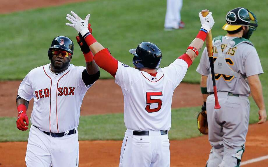 BOSTON, MA - APRIL 24: David Ortiz #34 of the Boston Red Sox is congratulated by teammate Jonny Gomes #5 of the Boston Red Sox after scoring against the Oakland Athletics in the fourth inning during the game on April 24, 2013 at Fenway Park in Boston, Massachusetts. (Photo by Jared Wickerham/Getty Images) Photo: Jared Wickerham