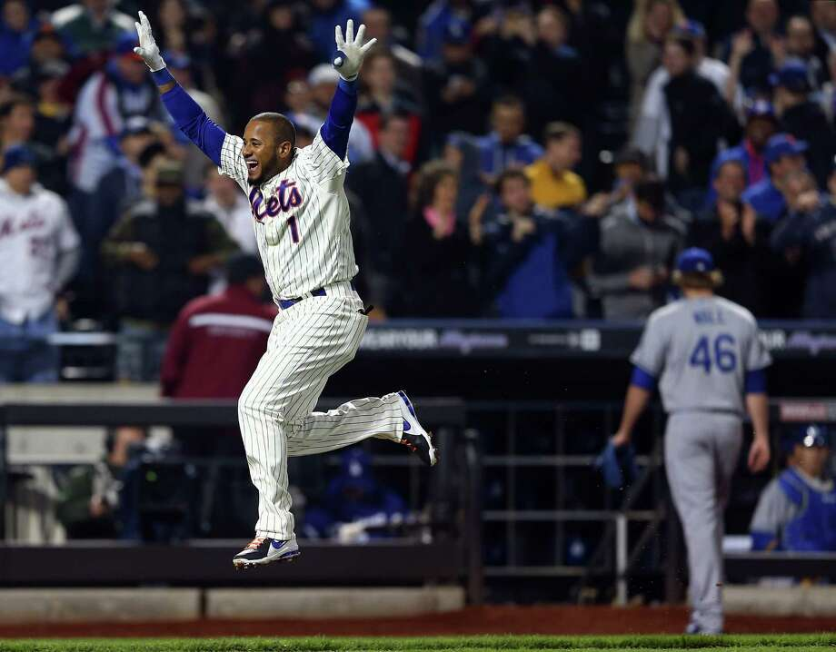 NEW YORK, NY - APRIL 24:  Jordany Valdespin #1 of the New York Mets celebrates his game winning grand slam as Josh Wall #46 of the Los Angeles Dodgers walks off the field on April 24, 2013 at Citi Field in the Flushing neighborhood of the Queens borough of New York City. The New York Mets defeated the Los Angeles Dodgers 7-3 in 10 innings. (Photo by Elsa/Getty Images) Photo: Elsa