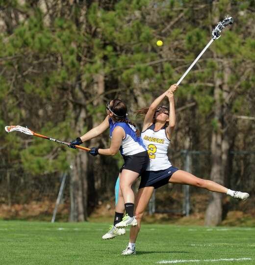 Albany Academy for Girl's Emma Hardy battles Hoosick Falls Liz Leva for the draw during their high s