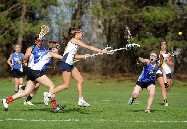 Albany Academy for Girl's Emma Hardy shoots for a score during their high school lacrosse game again
