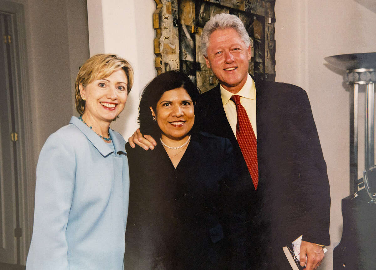 Grace Garcia, flanked by Bill and Hillary Clinton, now works to help elect pro-abortion-rights women.