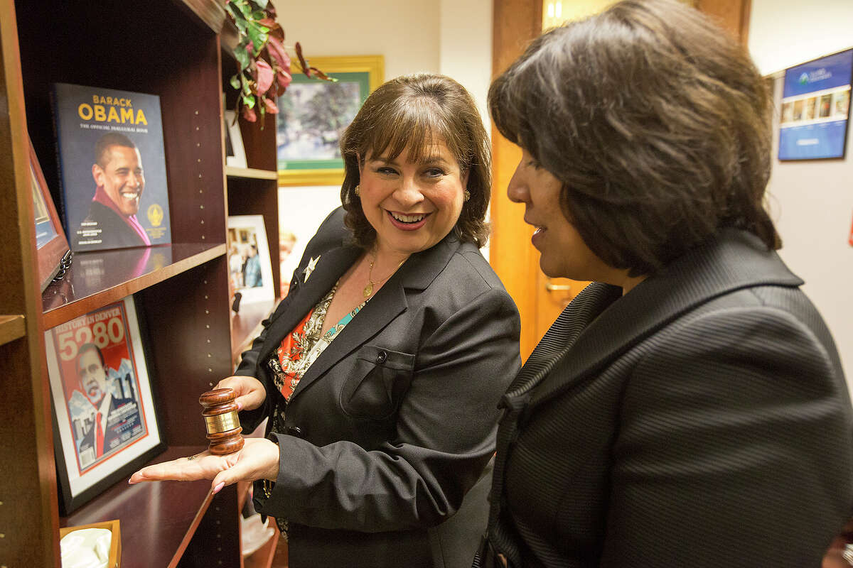 FOR METRO - Sen. Leticia Van de Putte , left, shows off a gavel to Grace Garcia during a meeting scheduled for the press at the State Capitol in Austin on Friday, April 12, 2013. MICHAEL MILLER / FOR THE EXPRESS-NEWS