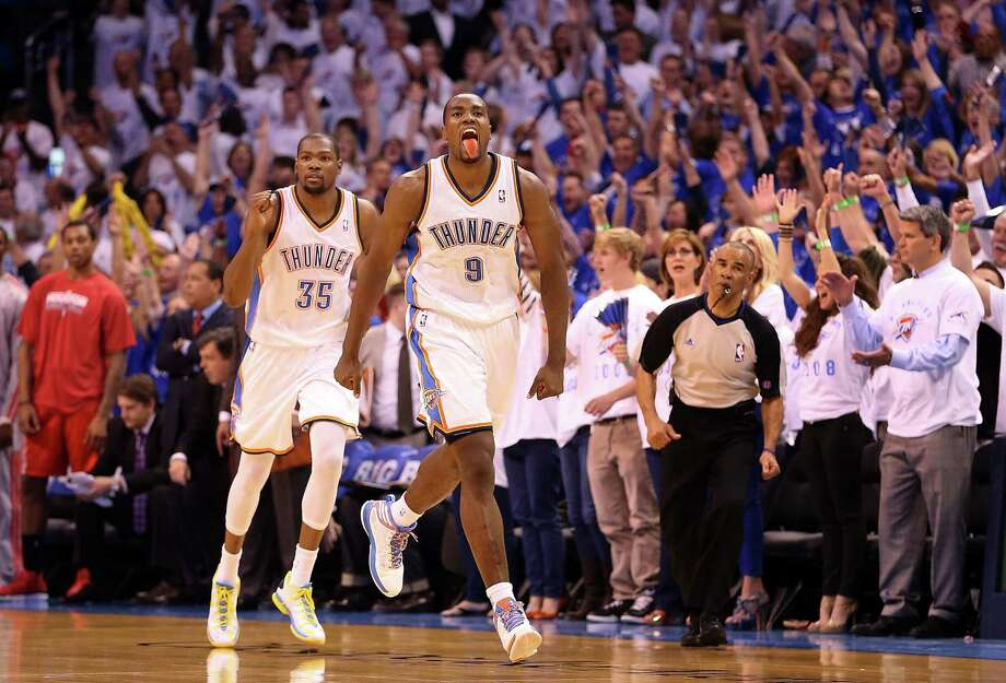 Oklahoma City's Serge Ibaka reacts in front of Kevin Durant after hitting a jumper in the fourth quarter of the Thunder's Game 2 victory. The Thunder trailed 95-91 with 3:27 left. Photo: Christian Petersen / Getty Images