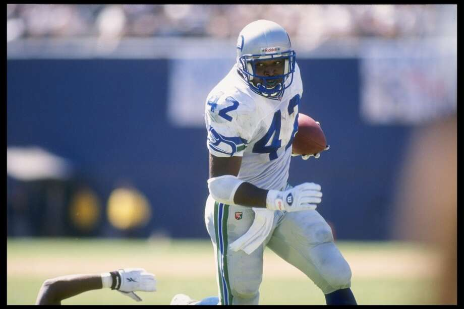 1990: Chris WarrenFourth round, 89th-overall pick | Position: Running back | College: FerrumWarren started out as a kick returner for two years, then got the starting RB job in 1992 and rushed for 1,017 yards that season. He went to three-straight Pro Bowls in 1993 through '95, all seasons in which he rushed for more than 1,000 yards. Though he ran for 1,545 yards in '94, his best year was arguably '95, when he scored 16 touchdowns and rushed for 1,346 yards. After eight years with the Seahawks, Warren went to Dallas in 1998 and finished his career as an Eagle after being traded to Philadelphia late in the 2000 season. Warren retired after that with 7,696 career rushing yards and 57 total touchdowns. Photo: Doug Pensinger, Getty Images