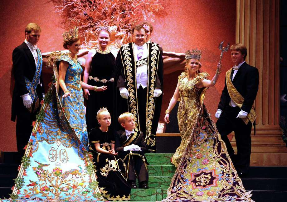 "Queen Tobin Deeann Simpson waves her scepter at the Order of the Alamo's coronation event ""The Court of Nature's Tapestry,"" in the Majestic Theatre on Wednesday, April 24, 2013. Photo: For The San Antonio Express-News / San Antonio Express-News"
