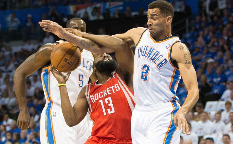April 24: Thunder 105, Rockets 102 Rockets guard James Harden is fouled by Thunder shooting guard Thabo Sefolosha during the first half.Thunder lead best-of-seven series 2-0 Photo: Smiley N. Pool, Houston Chronicle