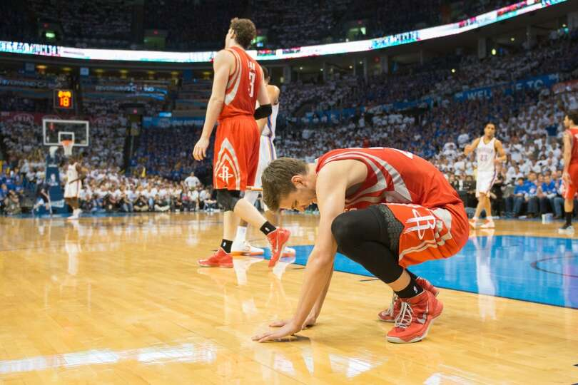 Rockets small forward Chandler Parsons reacts after bing called for a foul during the second half.