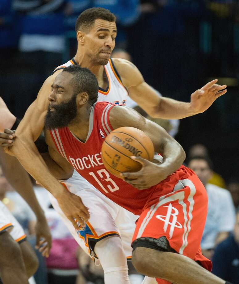 Rockets guard James Harden collides with Thunder guard Thabo Sefolosha. Photo: Smiley N. Pool, Houston Chronicle