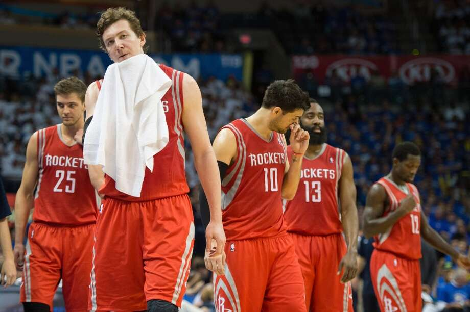 Houston Rockets center Omer Asik (3) walks onto the court with teammates Chandler Parsons (25),  Carlos Delfino (10), James Harden (13) and Patrick Beverley (12) after a timeout during the second half. Photo: Smiley N. Pool, Houston Chronicle