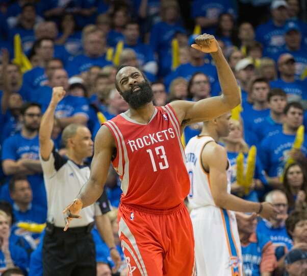 Rockets guard James Harden celebrates after a foul call goes the Rockets way during the second half.