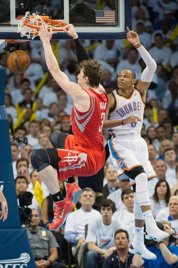 Rockets center Omer Asik dunks the ball past Thunder point guard Russell Westbrook. Photo: Smiley N. Pool, Houston Chronicle