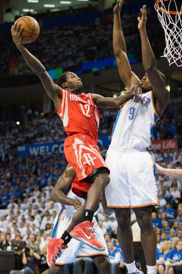 Rockets point guard Patrick Beverley, making his first career start, shoots over Serge Ibaka of the