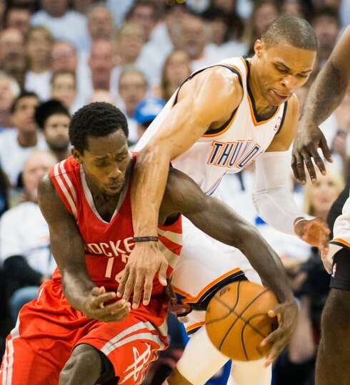 Russell Westbrook of the Thunder fights for possession with Rockets point guard Patrick Beverley.