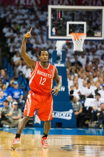 Rockets point guard Patrick Beverley celebrates a made basket during the first half.  Beverley score