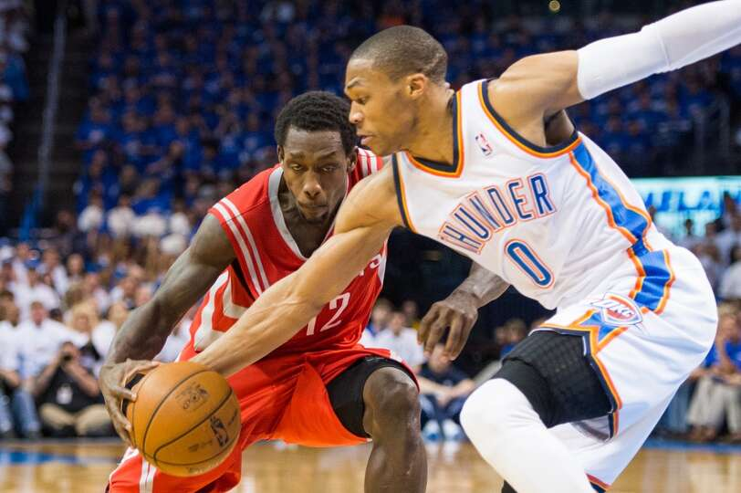 Thunder point guard Russell Westbrook (0) steals the ball from Rockets point guard Patrick Beverley