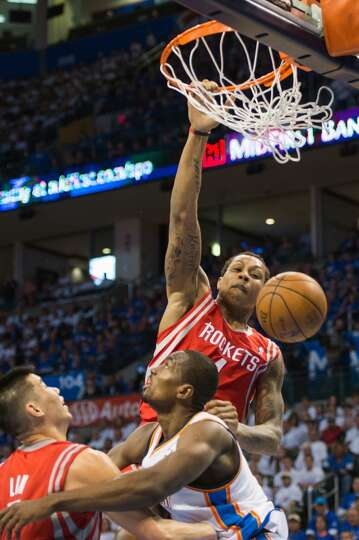 Rockets power forward Greg Smith goes up for a dunk during the first half.  Smith was called for a t
