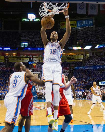 Thunder small forward Kevin Durant dunks during the first half.  Durant had 29 points in the game.