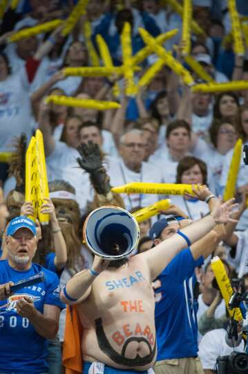 Oklahoma City fans try to distract a Houston shooter at the free throw line during the second half.