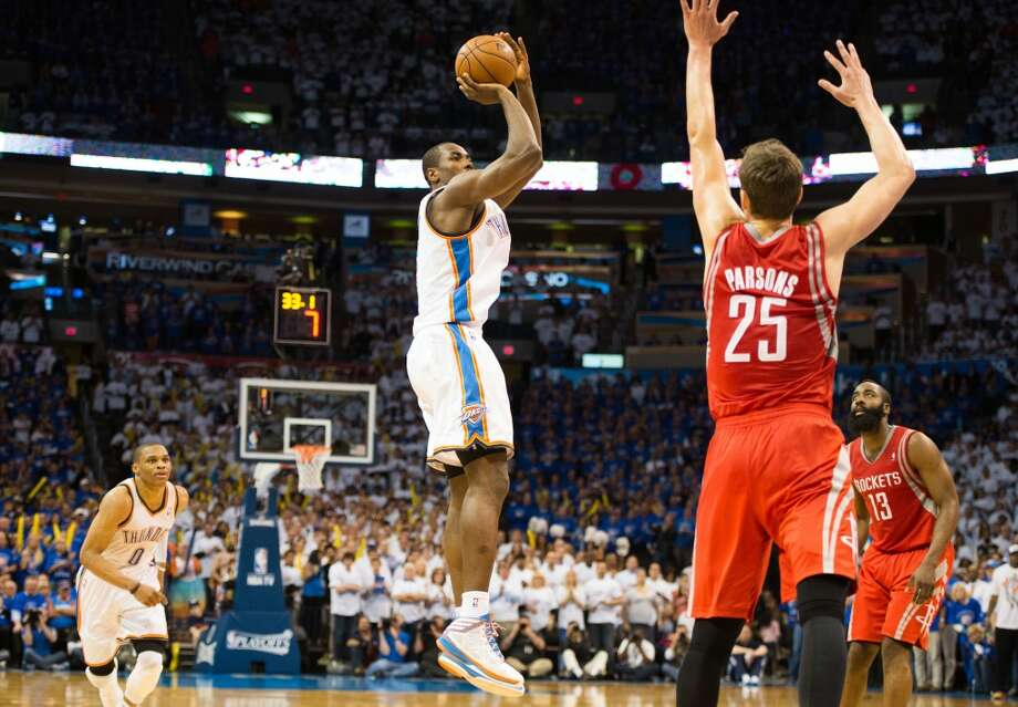 City Thunder forward Serge Ibaka makes a jump shot over Rockets forward Chandler Parsons (25) with 31.9 seconds left to play to give the Thunder a 5-point lead. Photo: Smiley N. Pool, Houston Chronicle