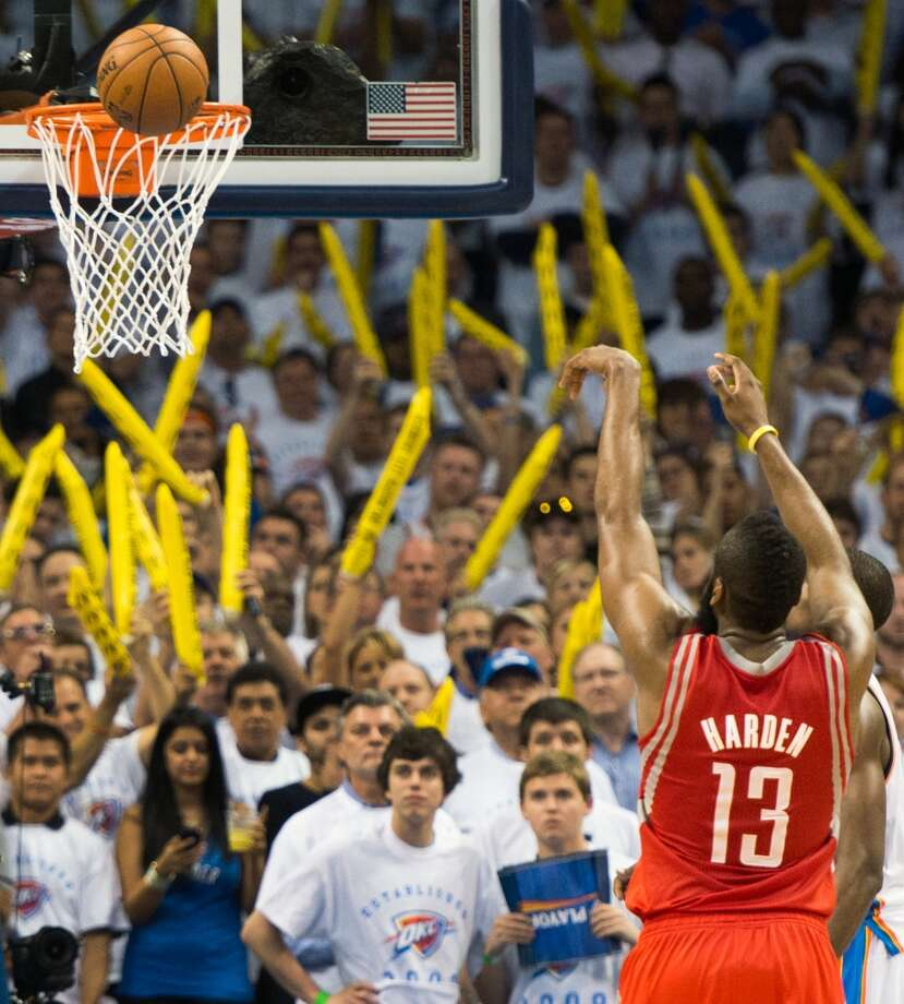 Rockets guard James Harden misses a free throw during the final minute. Photo: Smiley N. Pool, Houston Chronicle