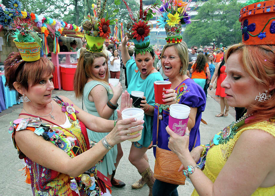 "A group of revelers calling themselves the ""Potheads"" get together to celbrate NIOSA as it begins its's 2013 run at La Villita on  April 23 2013.  From left are Kay Rust, Valyn Boothe, Kelly Frank, Yvette Joyner and Joy Lindsey. Photo: TOM REEL"