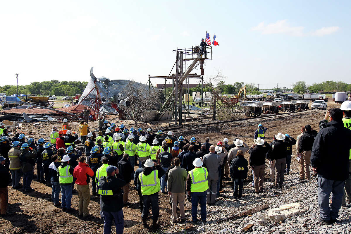 Workers pause for a memorial service at the site of the fire and explosion in West, Texas on April 24 2013.