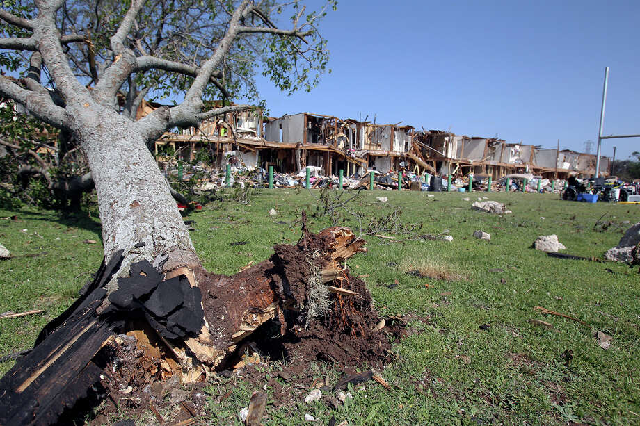 Trees in nearby yards were knocked down at the site of the fire and explosion in West, Texas on  April 24 2013. Photo: For The San Antonio Express-News