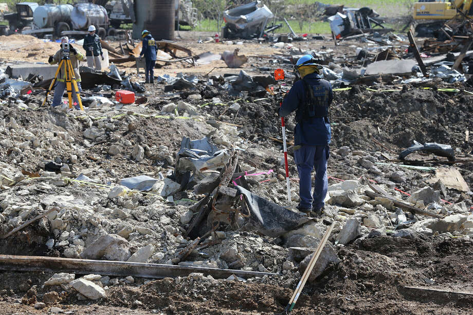 Forensic mappers measure the crater at the site of the fire and explosion in West, Texas on  April 24 2013. Photo: For The San Antonio Express-News