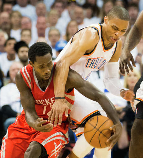 Rockets guard Patrick Beverley (left) constantly harassed the Thunder's Russell Westbrook on Wednesday, to the point Westbrook refused a helping hand up. Photo: Smiley N. Pool, Staff / © 2013  Houston Chronicle