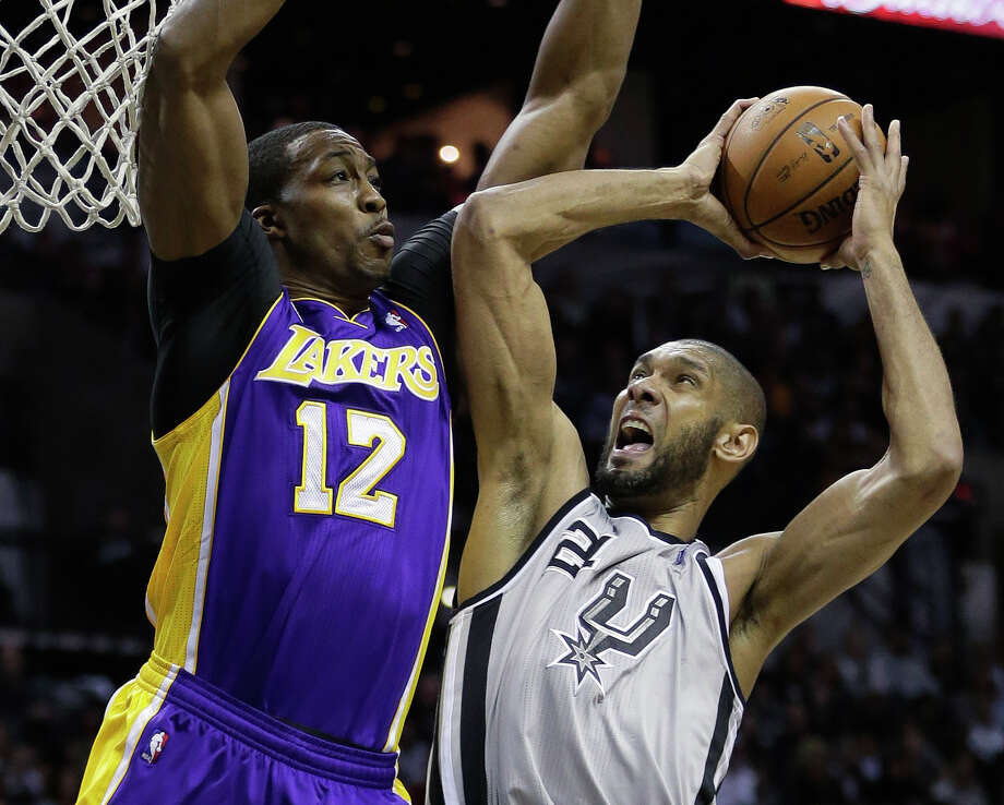 Tim Duncan, right, and the Spurs took a 2-0 series lead over Dwight Howard and the Lakers with a 102-91 win. Photo: Eric Gay, STF / AP