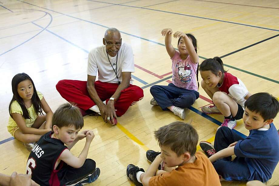 Joe Ellis, who played for USF and the Warriors, talks with students after one of his basketball clinics at the Peninsula Jewish Community Center in Foster City. Photo: Laura Morton, Special To The Chronicle