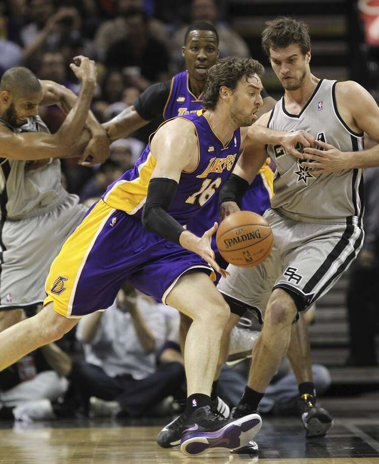 Los Angeles Lakers' Pau Gasol gets around San Antonio Spurs' Tiago Splitter as Tim Duncan fights off Dwight Howard in the the first half of game 2 in the first round of the NBA Playoff at the AT&T Center, Wednesday, April 24, 2013.