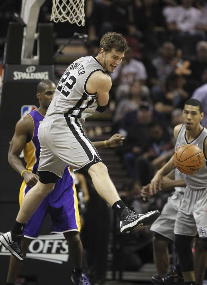 San Antonio Spurs' Tiago Splitter looks over as he loses the ball against the Los Angeles Lakers in the second half of game 2 in the first round of the NBA Playoff at the AT&T Center, Wednesday, April 24, 2013. The Spurs won102-91 and lead the series 2-0.