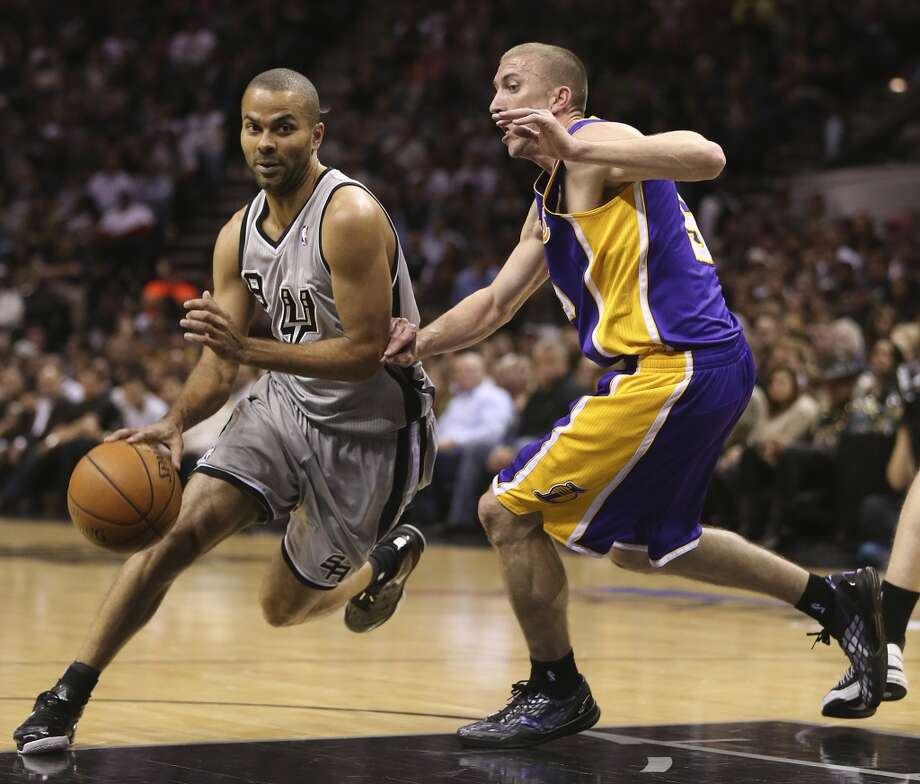 San Antonio Spurs' Tony Parker drives around Los Angeles Lakers' Steve Blake in the first half of game 2 in the first round of the NBA Playoff at the AT&T Center, Wednesday, April 24, 2013.