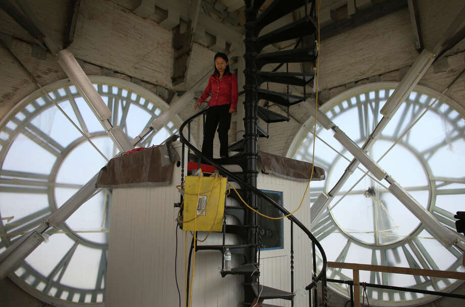 King Street Station project manager Trevina Wang descends stairs in the clock tower after the reopening of the restored waiting area at the King Street Station. The station was restored and given seismic upgrades. Enough steel was added in the building to frame a 20 story high-rise, said Wang.  Photo: JOSHUA TRUJILLO, SEATTLEPI.COM / SEATTLEPI.COM