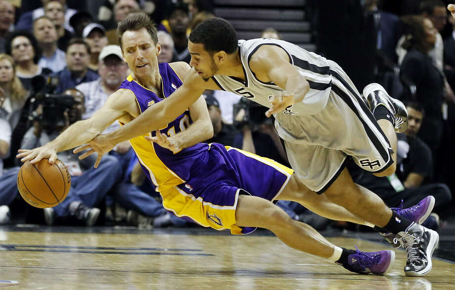 Lakers guard Steve Nash and Spurs counterpart Cory Joseph chase after a loose ball during the second half of the Spurs' 102-91 Game 2 victory at the AT&T Center. Photo: Edward A. Ornelas / San Antonio Express-News