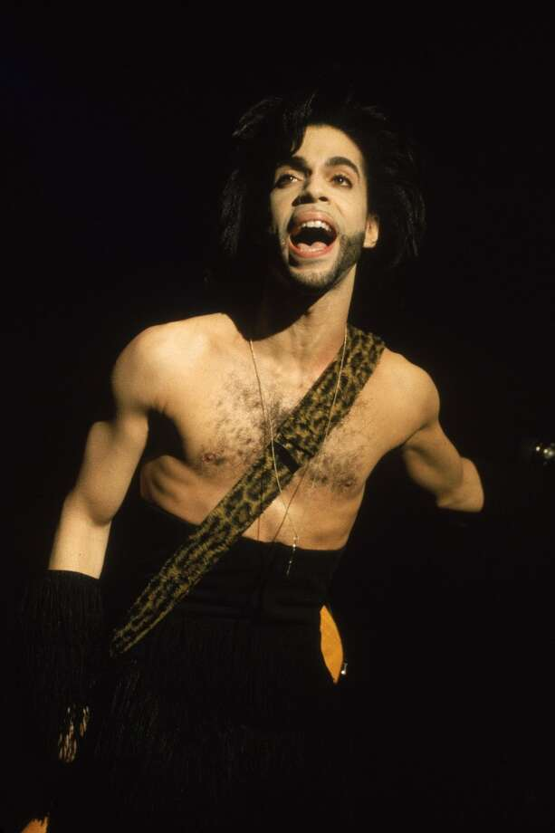 American singer and songwriter Prince performs in concert, barechested with a guitar strapped at his waist, Minneapolis, Minnesota, April 30, 1990. (Photo by Frank Micelotta/Getty Images)