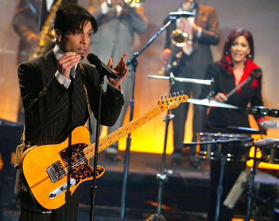 "Prince, with Sheila E, at ""The Tonight Show with Jay Leno\"" at the NBC Studios in Burbank, Ca. Friday, Dec. 13, 2002. Photo by Kevin Winter/ImageDirect."