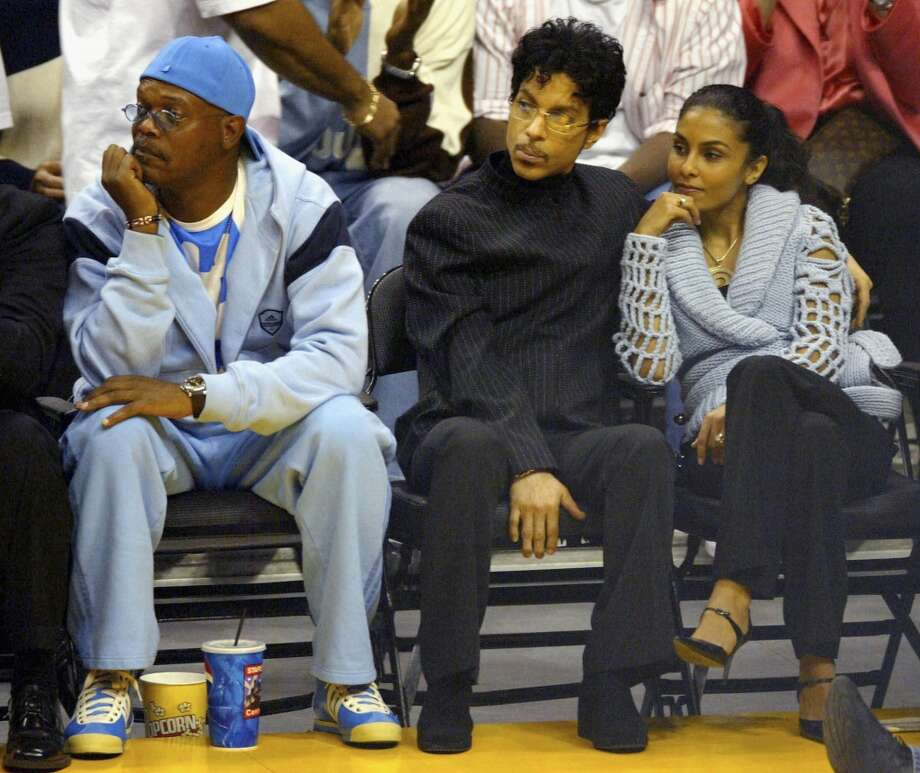 Actor Samuel L. Jackson, Musician Prince and wife Manuela Testolini watch the Los  Angeles Lakers game against the Miami Heat at the Staples Center December 25, 2004 in Los Angeles, California. (Photo by Matthew Simmons/Getty Images)