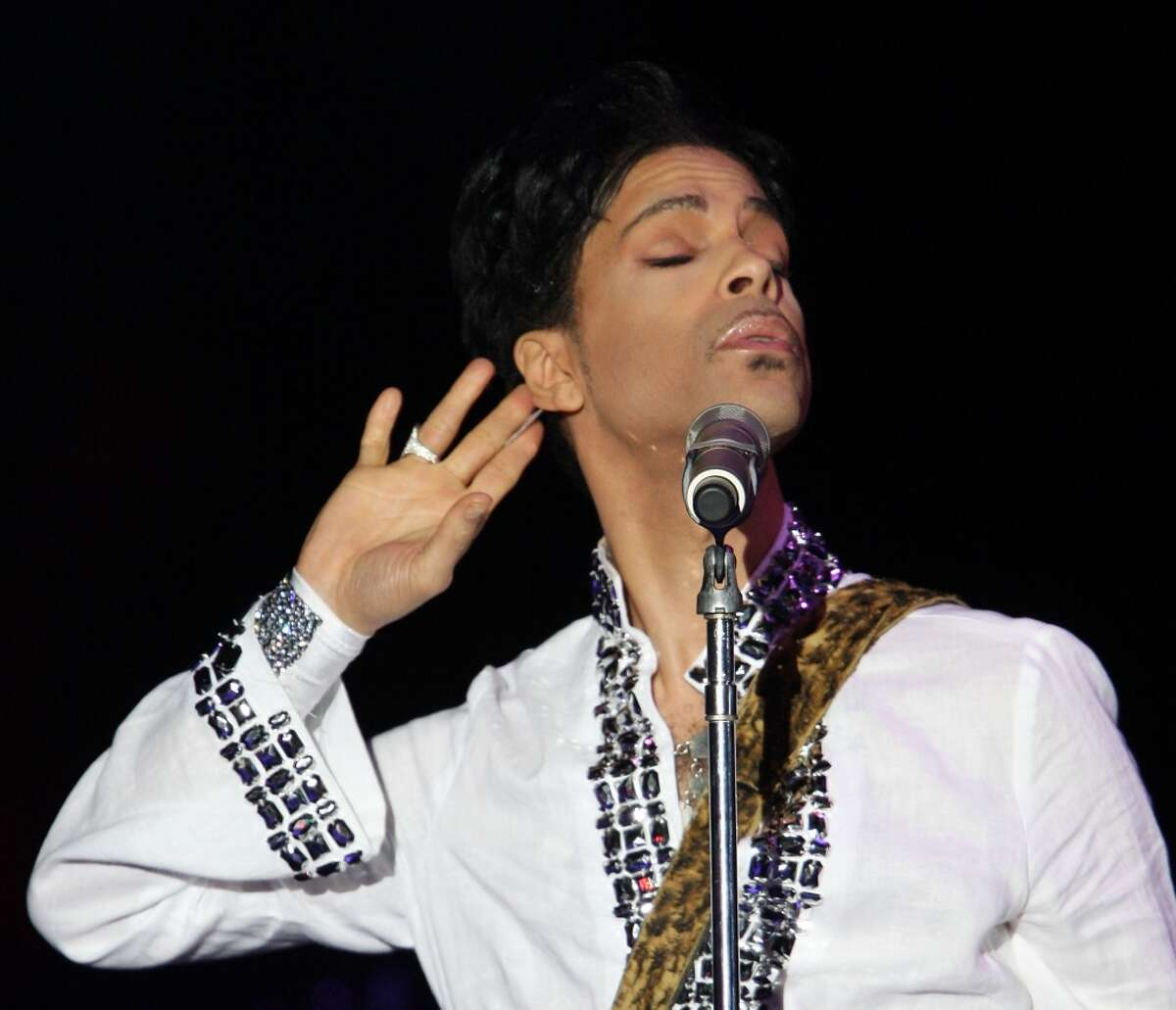 In this file photo, Prince performs during day 2 of the Coachella Valley Music and Arts Festival held at the Empire Polo Field on April 26, 2008 in Indio, California. Click ahead to see vintage photos of Prince.