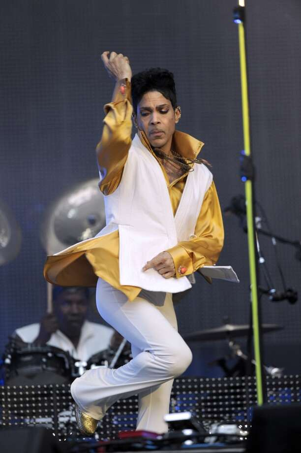 US singer and musician Prince (born Prince Rogers Nelson) dances as he performs on stage at the Stade de France in Saint-Denis, outside Paris, on June 30, 2011. AFP PHOTO BERTRAND GUAY (Photo credit should read BERTRAND GUAY/AFP/Getty Images)