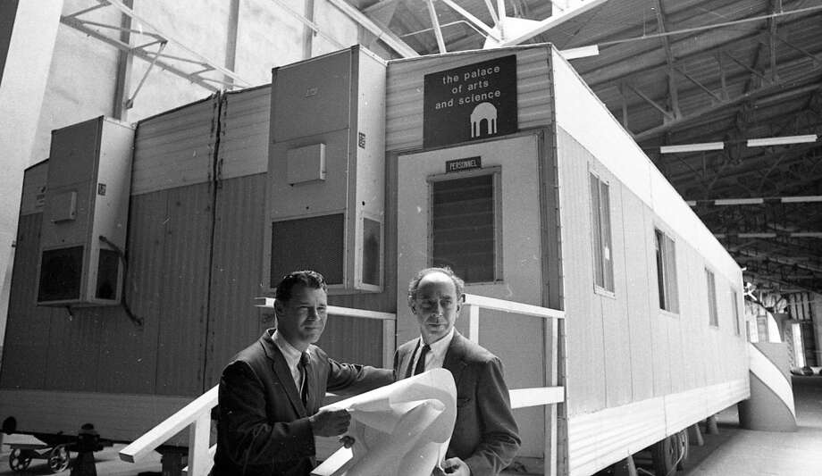 July 3, 1969: San Francisco supervisor Jack Ertola with Exploratorium founder Frank Oppenheimer, looking over plans in the vast empty space near the Palace of Fine Arts. I\'m guessing that trailer behind them was filled with Christmas tree lights and bubble solution.