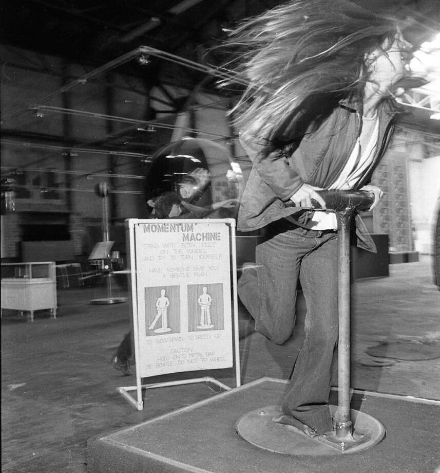 Nov. 14, 1973: An early ride on the Momentum Machine. (I recall a garbage can nearby for vomit.) Note the simplicity of all the early exhibits, and the industrial feel of the warehouse. Even when the Exploratorium was a year it two old, it felt like it had been around for decades.