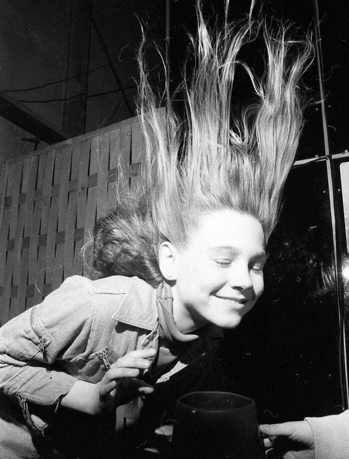 Jan. 18, 1977: I\'ve always said, if you walk out of the Exploratorium with your original hairdo intact, then you\'re not doing it right. This is from a construction cone and a blower that were modified into a makeshift wind tunnel.