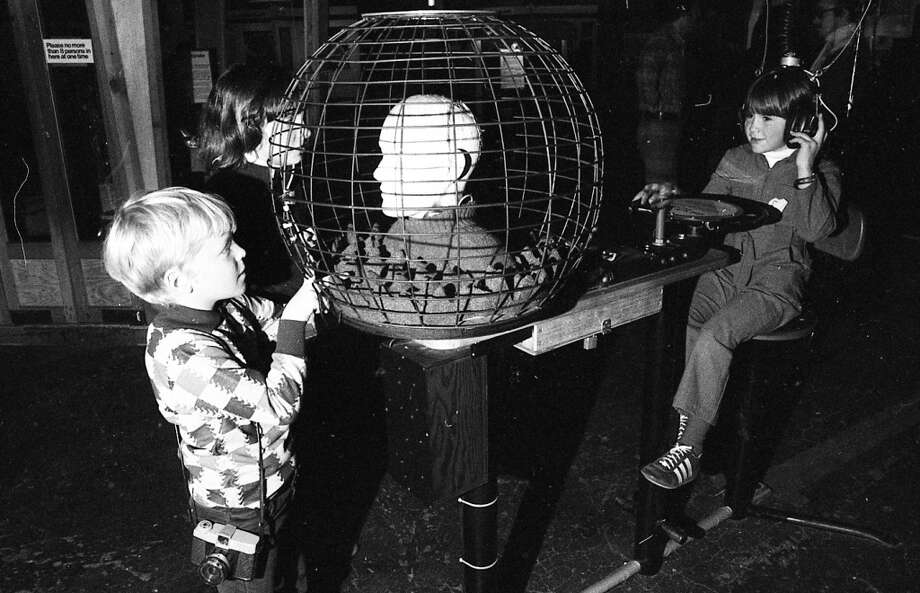 """Jan. 18, 1977: I\'m not sure what fundamental of science this exhibit demonstrated, but the makers of the \""""Hellraiser\"""" horror movie series owe a royalty. Note the sweet camera being toted around by the kid on the left."""